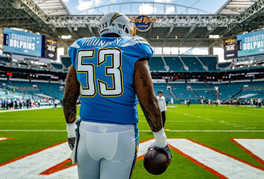 Chargers center Mike Pouncey warms up before a game against the Dolphins on Sept. 29.