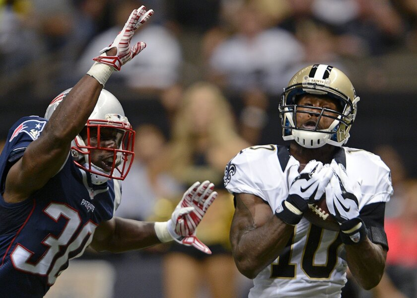 New Orleans Saints wide receiver Brandin Cooks (10) pulls in a touchdown reception in front of New England Patriots strong safety Duron Harmon (30) in the first half of a preseason NFL football game in New Orleans, Saturday, Aug. 22, 2015. (AP Photo/Bill Feig)