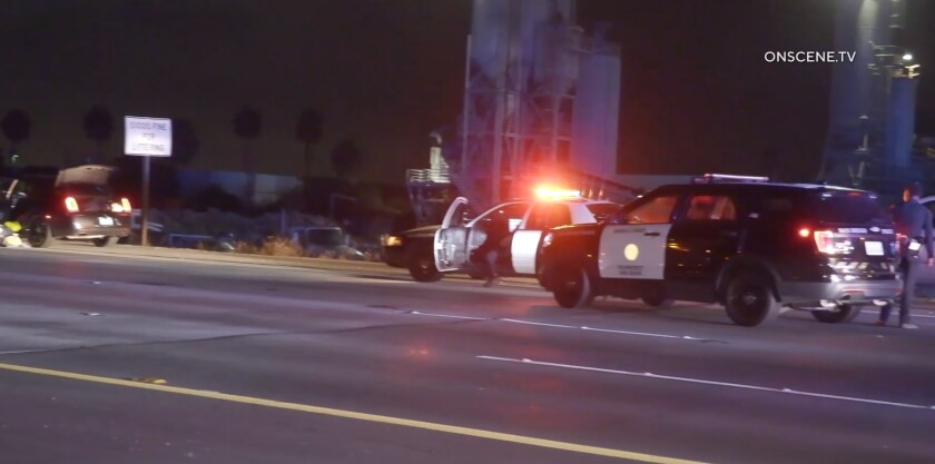 San Diego police vehicles stopped a black Chrysler sedan on west SR-905 late Tuesday night in connection with a reported shooting in Barrio Logan.