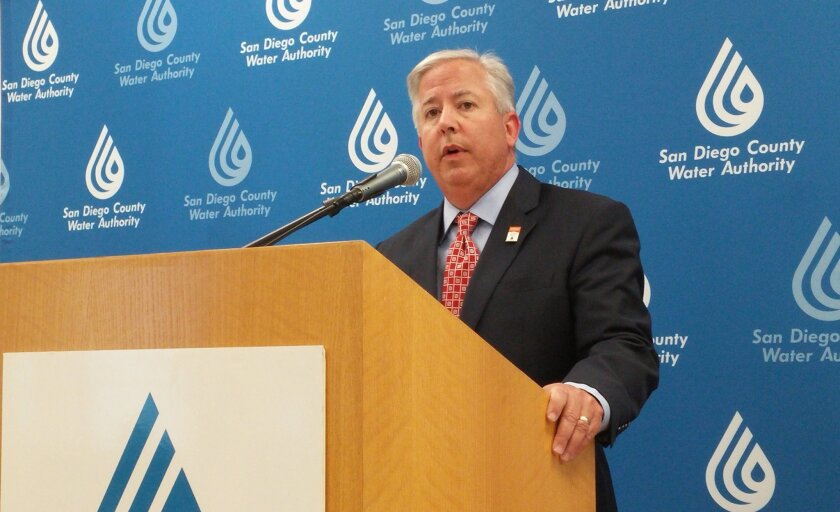 Dennis A. Cushman, assistant general manager of the San Diego County Water Authority, speaks at a Wednesday evening press conference about the authority's legal victories in ongoing litigation against Metropolitan Water District.