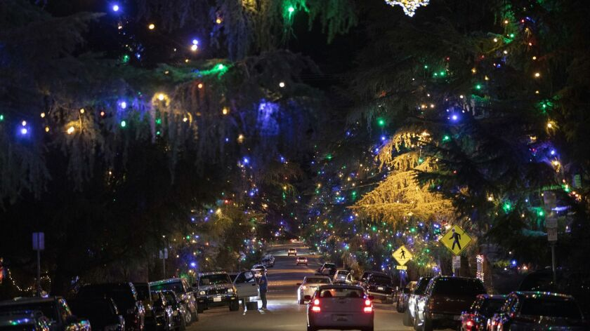 Motorists cruise Santa Rosa Avenue, better known as Christmas Tree Lane, in Altadena in 2018.