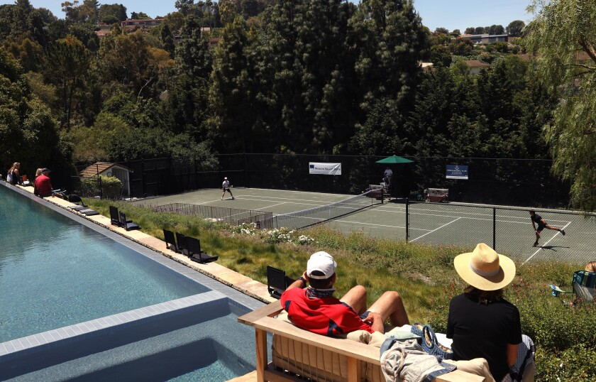 A few friends and family watch a match between Brandon Holt, left, and Marcos Giron at the Homecourt Advantage tournament in Rolling Hills on Sunday.