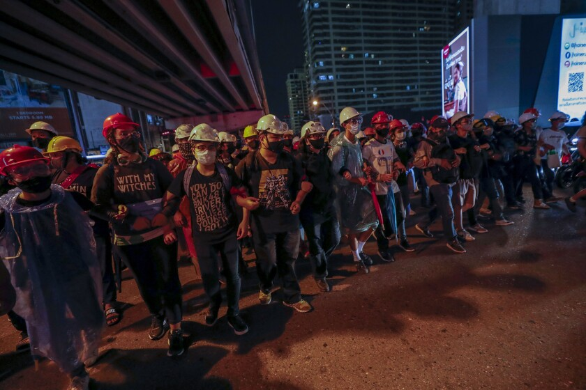 Pro-democracy activists march to the prime minister's office in Bangkok, Thailand.