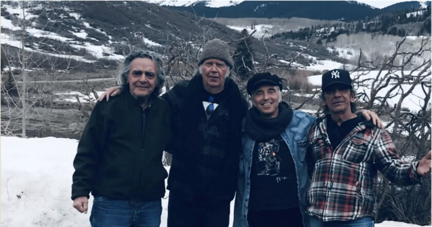 Billy Talbot, from left, Neil Young, Nils Lofgren and Ralph Molina