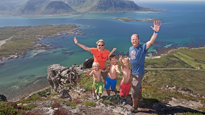 A family stands on a summit in Lofoten archipelago in Norway in 2014. Norway has been judged to be the happiest country in the world.