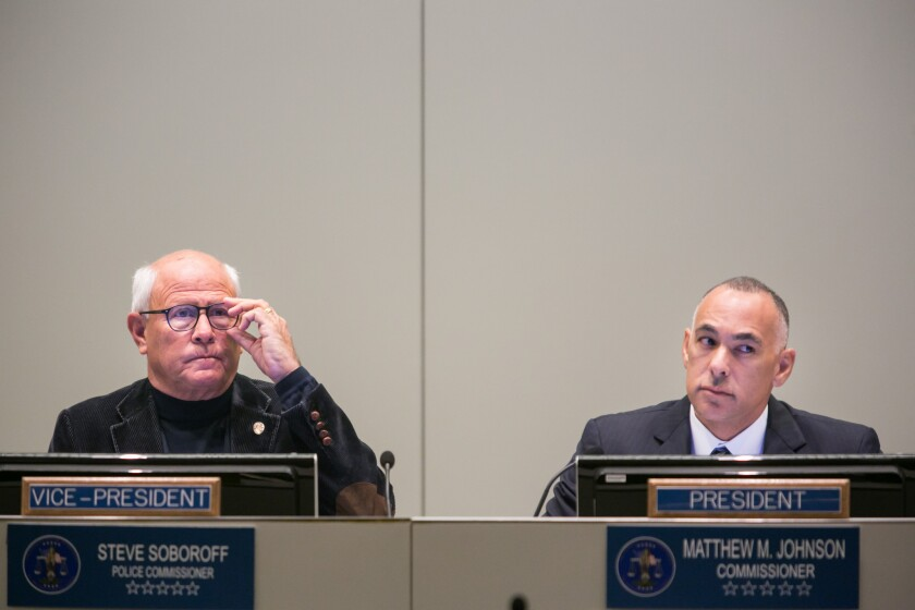 Police Commissioner Steve Soboroff, left, and Matthew Johnson, the panel's president at Tuesday's L.A. Police Commission meeting.