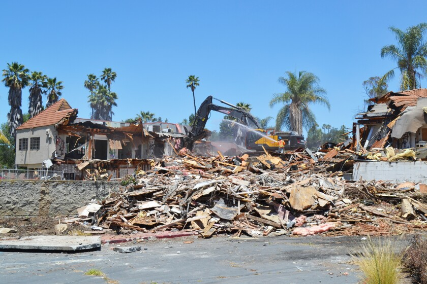 Workers began tearing down StoneRidge Country Club's former clubhouse on Tuesday.