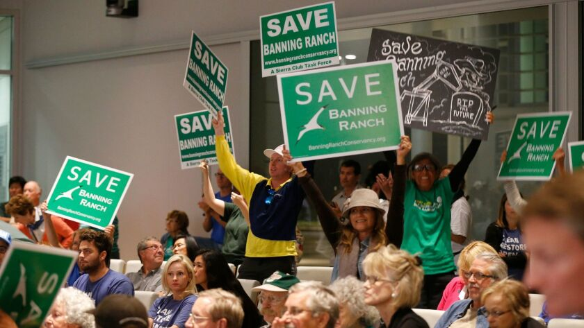 Protesters against the development of Newport Banning Ranch celebrate in September after the Coastal Commission rejected a large development project proposed for the property.