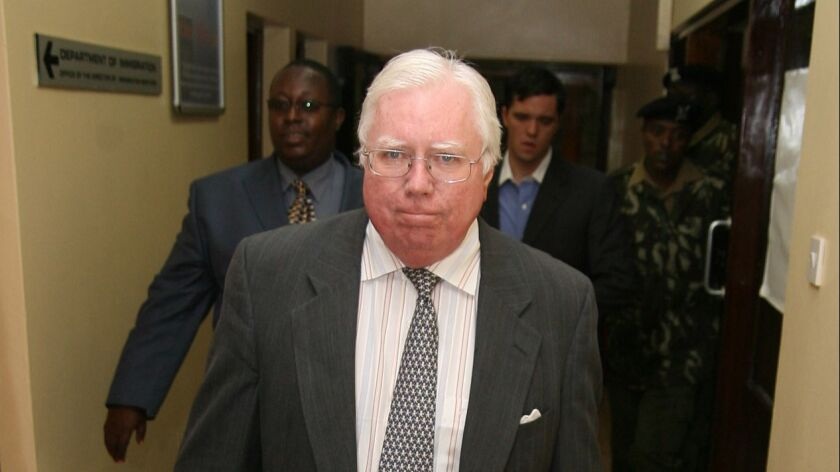 "Jerome Corsi, who wrote ""The Obama Nation: Leftist Politics and the Cult of Personality, walks down"