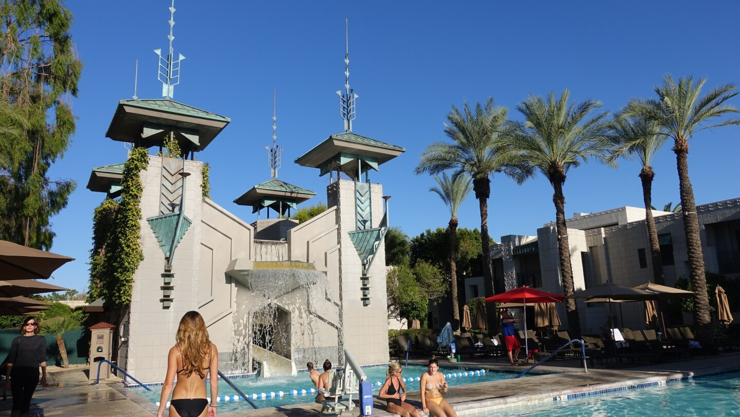 Guests enjoy the Paradise Pool, complete with kid-friendly waterslide, at the Arizona Biltmore, a Waldorf-Astoria Resort.