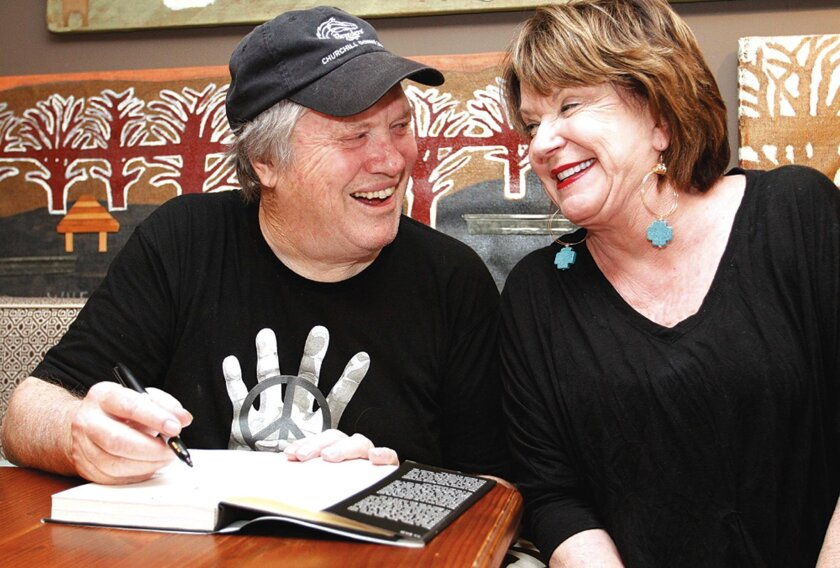"FILE - In this March 25, 2012 file photo, saxophonist Bobby Keys signs a copy of his autobiography, ""Every Night's a Saturday Night: The Rock 'n' Roll Life of Legendary Sax Man Bobby Keys,"" for Jo Claire Swayze, right,  in Greenwood, Miss. Keys, who performed on recordings with John Lennon and Eric"