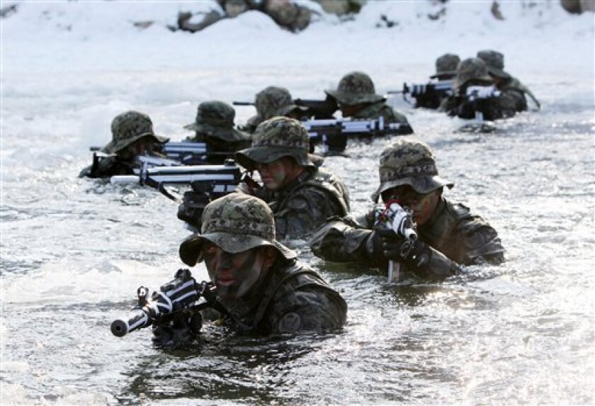 """South Korean Special Army soldiers cross a river during their military winter exercise in Pyeongchang, east of Seoul, South Korea, Monday, Jan. 19, 2009. North Korea's main newspaper said Monday that the communist nation does not engage in """"empty talk,"""" heightening tensions surrounding its threat t"""