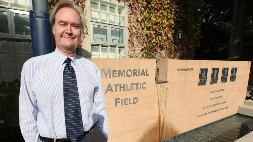Prep Headmaster Peter Bachmann in front of the school's new memorial wall, bench and reflecting pond