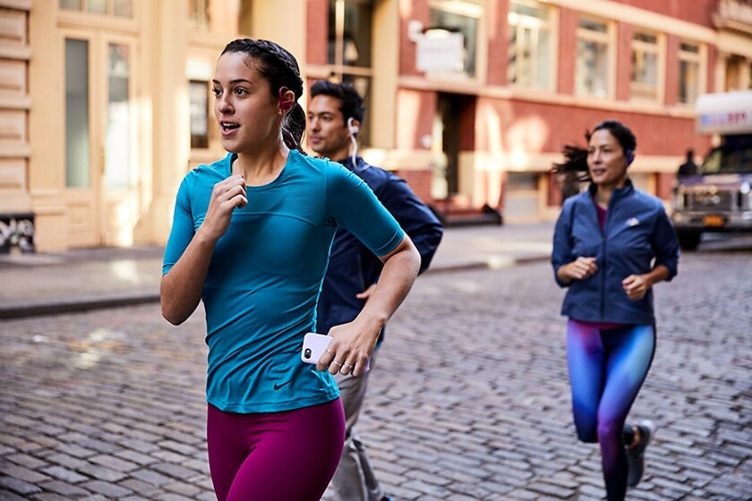 Run a 5K alone or with new friends Aaptiv, a fitness app.