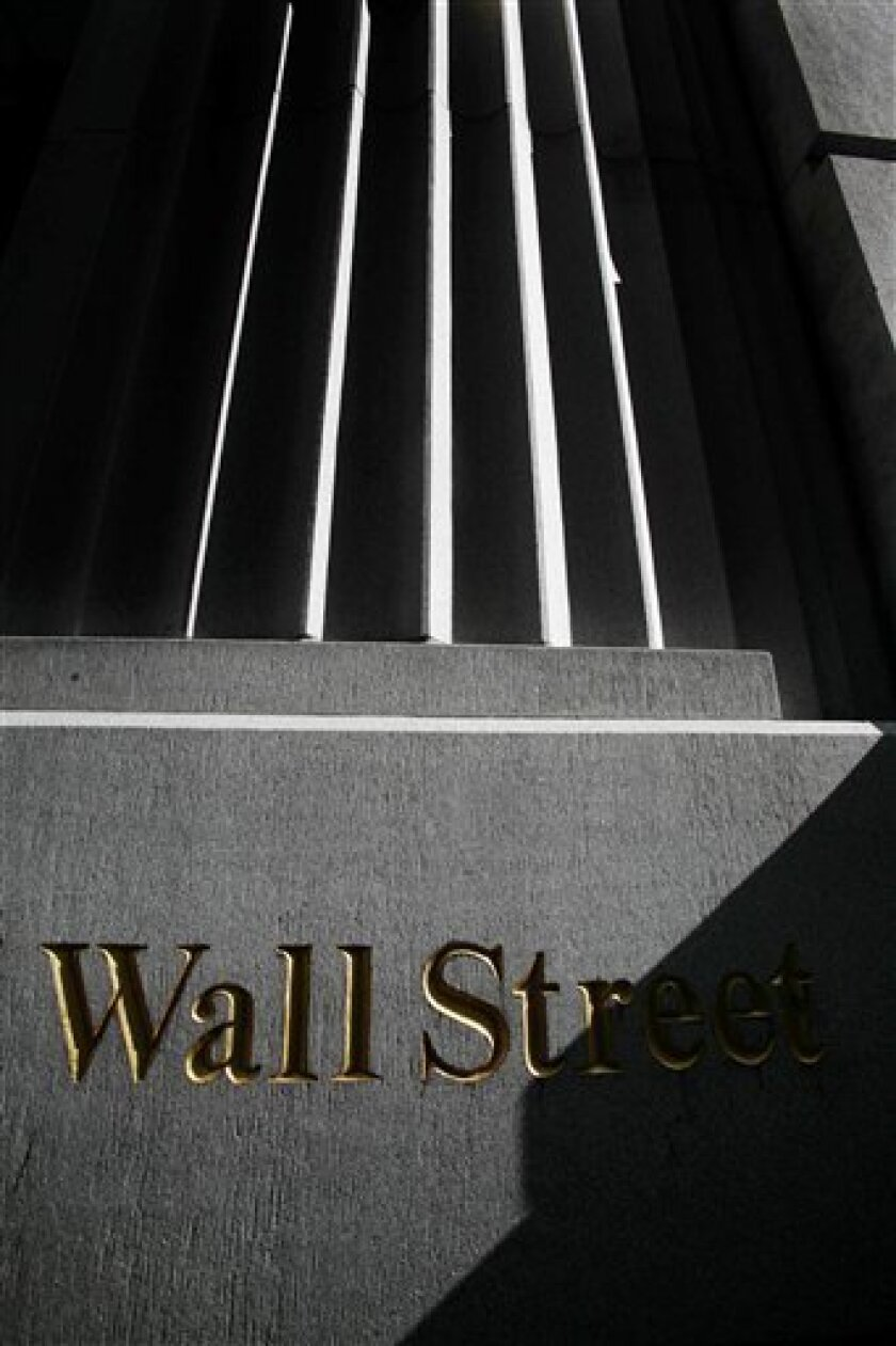 FILE - In this March 8, 2010 file photo, a sign for Wall Street is shown near the New York Stock Exchange. (AP Photo/Mark Lennihan, file)