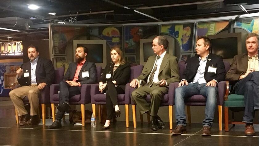 Representatives of the cannabis and legal professions speak about business opportunities in the industry at a panel discussion in San Diego Feb. 9, 2017.