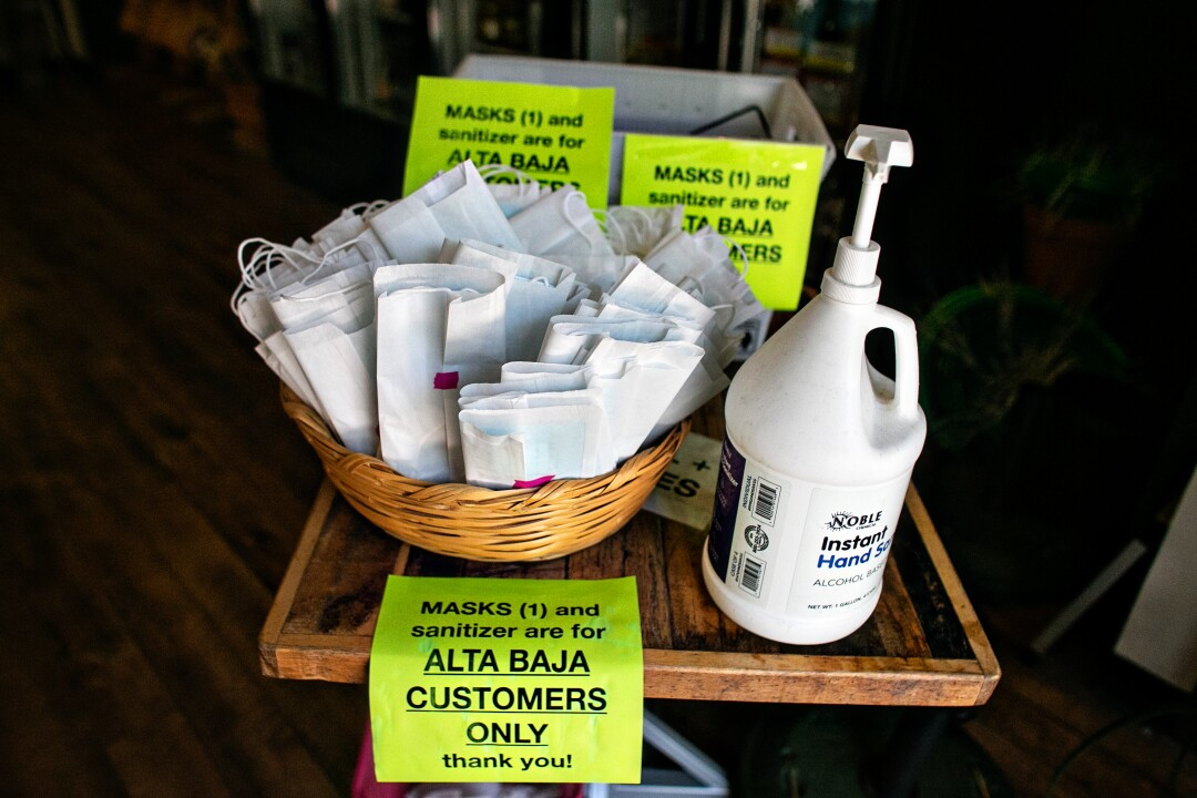 Alta Baja Market provides masks and hand sanitizer to shoppers as they enter the store.