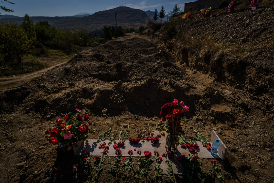 Red flowers adorn a grave at a military cemetery in Stepanakert, Nagorno-Karabakh.
