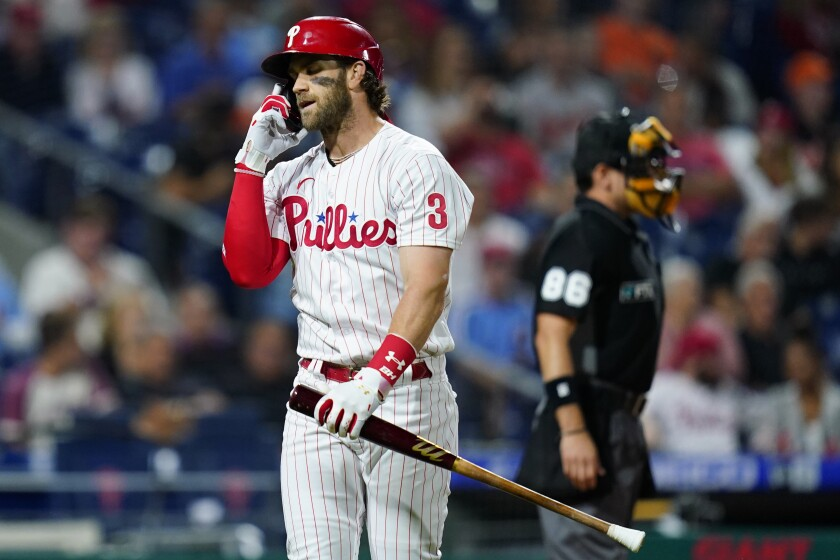 Philadelphia Phillies' Bryce Harper reacts after striking out against Baltimore Orioles pitcher John Means during the fourth inning of an interleague baseball game, Monday, Sept. 20, 2021, in Philadelphia. (AP Photo/Matt Slocum)