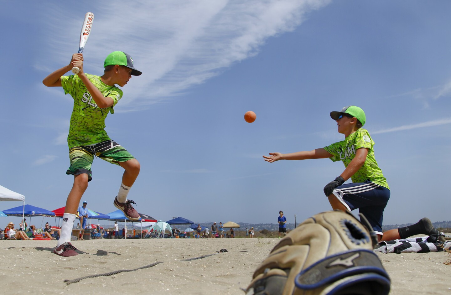Max Snakenborg takes a pitch from teammate, Colton walker during tournament play agains the Best Mates in the OMBAC Junior OTL Tournament on Fiesta Island.
