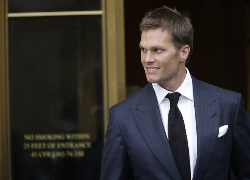 New England Patriots quarterback Tom Brady leaves a federal courthouse in New York on Aug. 12