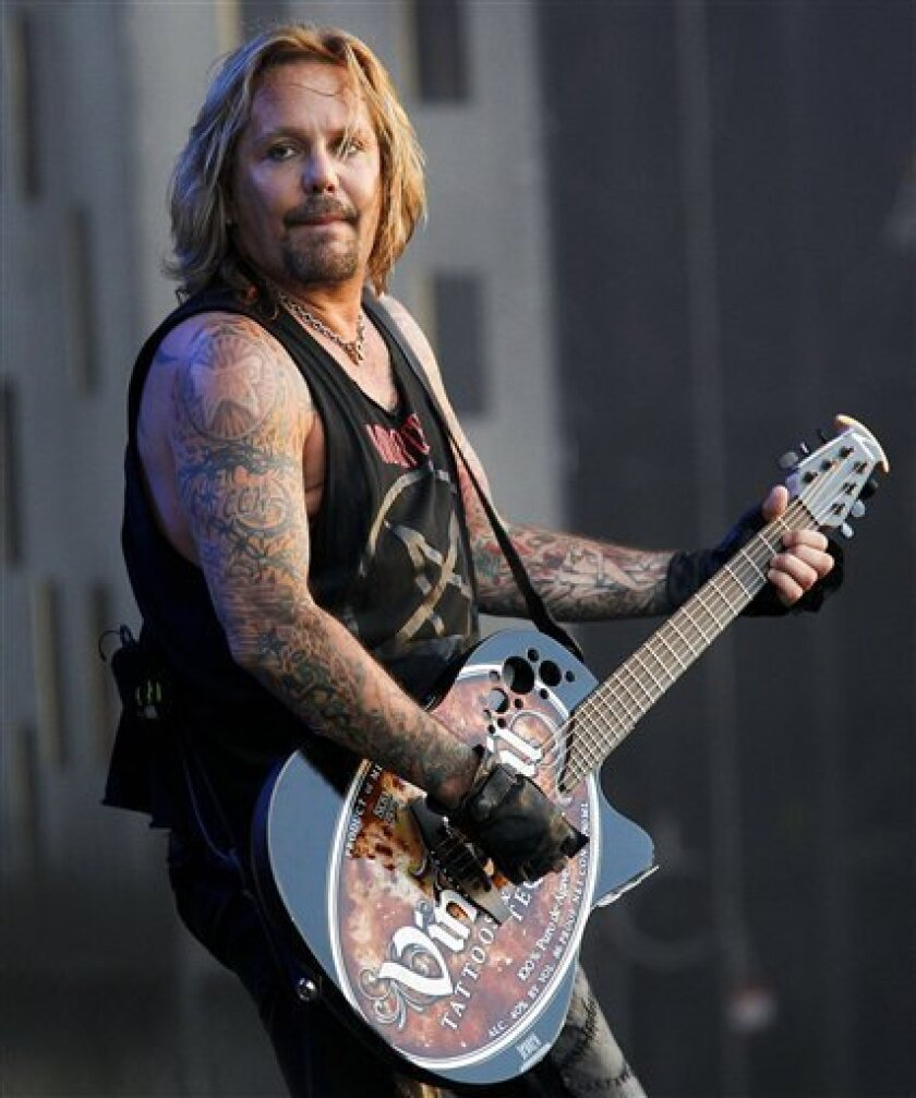 FILE - In this Aug. 5, 2010 file photo, singer Vince Neil performs at the Wacken Open Air Festival in Wacken, Schleswig Holstein, northern Germany. (AP Photo/Axel Heimken)