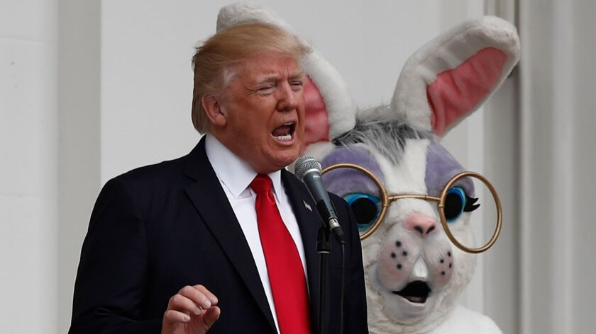 President Donald Trump, joined by the Easter Bunny, speaks from the Truman Balcony during the annual