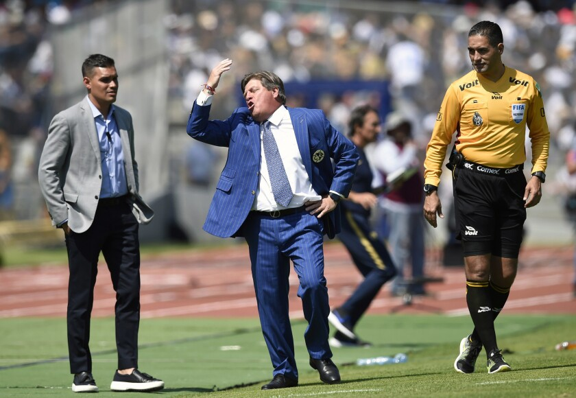 The coach of America, Miguel Herrera, gestures during the Mexican Apertura football tournament match against Pumas at the Olimpico Universitario stadium in Mexico City, on February 17, 2019.