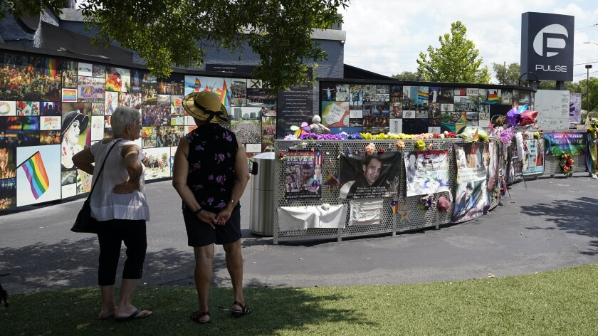 Visitors pay tribute to the display outside the Pulse nightclub memorial Friday in Orlando.