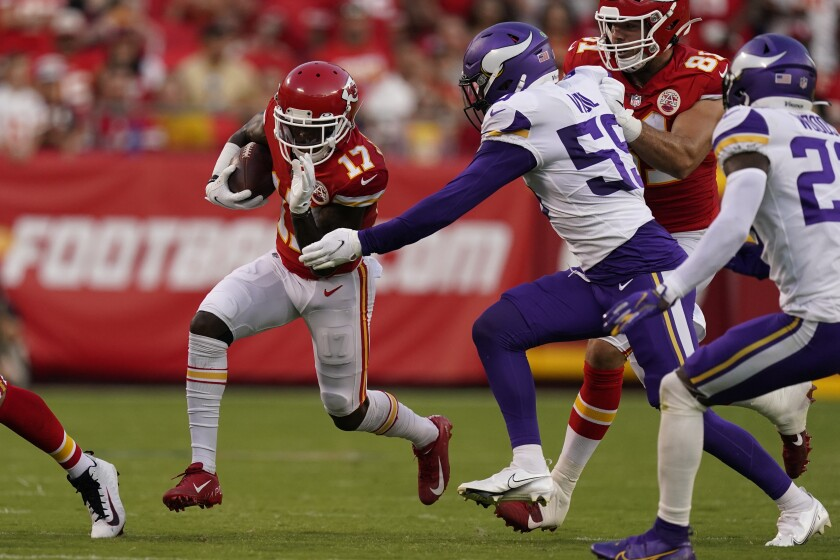 Kansas City Chiefs wide receiver Mecole Hardman (17) as Minnesota Vikings linebacker Nick Vigil (59) defends during the first half of an NFL football game Friday, Aug. 27, 2021, in Kansas City, Mo. (AP Photo/Charlie Riedel)