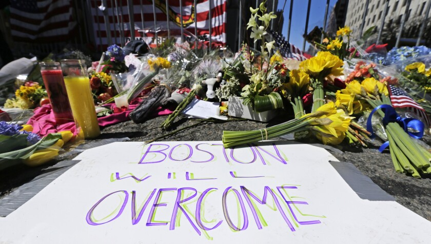 Photograph, flowers, signs left after 2013 Boston Marathon bombing