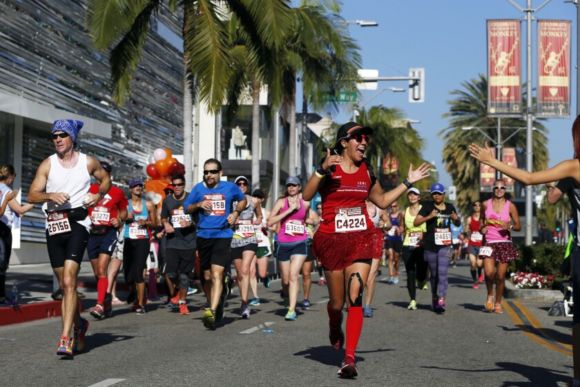 Participants cross mile 17 on Rodeo Drive during the 31st Sketchers Performance Los Angeles Marathon on Feb. 14 in Beverly Hills. (Patrick T. Fallon/ For The Los Angeles Times)