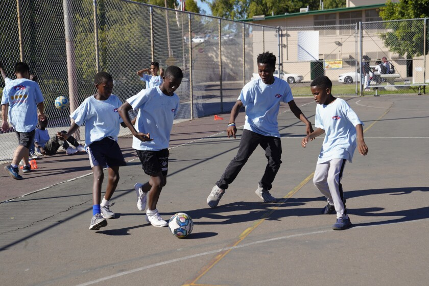 Boys from the STARPAL program play a scrimmage game of futsal at Colina Del Sol Park. The boys spend up to two hours a day in the program where they can get assistance with homework before playing soccer/futsal.