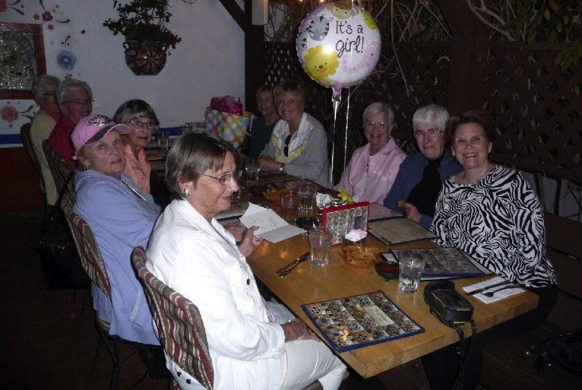 A Del Mar knitting group recently held a surprise baby shower for a local busboy.
