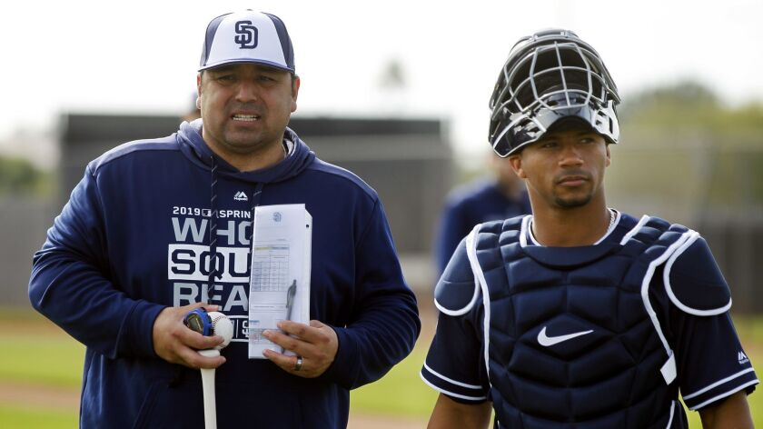 Padres bench coach Rod Barajas, a former major league catcher, works with Francisco Mejía.