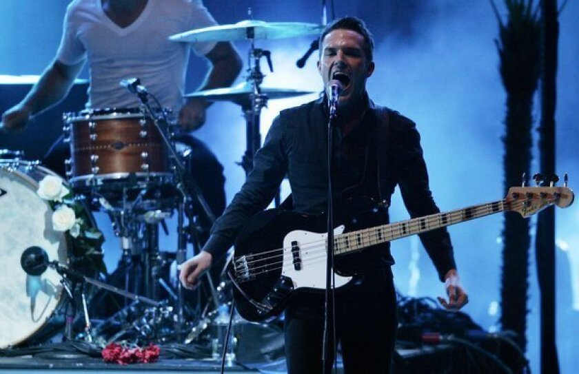 "The Killers, here performing at the Hollywood Bowl in 2009, have released a video for the song ""Here With Me"" that was directed by Tim Burton."