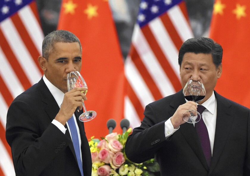 President Obama and Chinese President Xi Jinping drink a toast at a banquet in Beijing on Nov. 12.