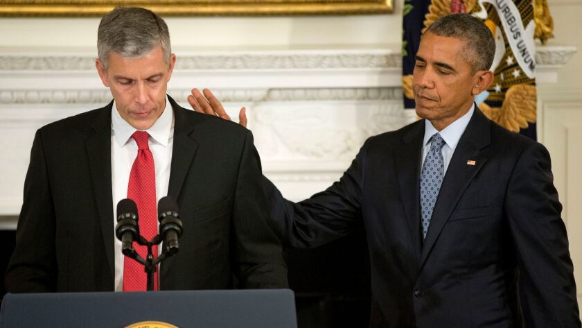 President Obama pats Education Secretary Arne Duncan's back in the White House on Oct. 2, 2015, as Duncan announces that he will be stepping down after 7 years in the Obama administration.