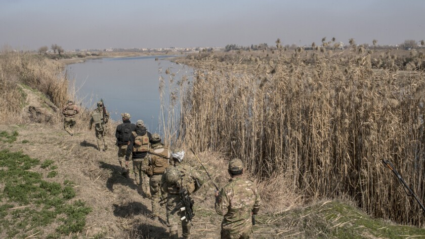 An Iraqi Emergency Response Division unit advances along the Tigris River to the southernmost Islamic State-occupied neighborhoods of west Mosul.