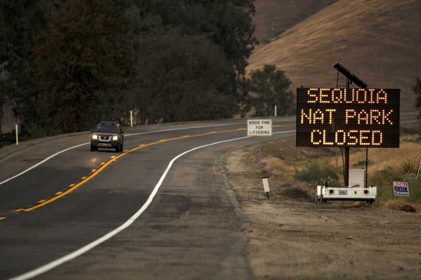 A sign warns motorists of the closure of Sequoia National Park as the KNP Complex fire threatens the area
