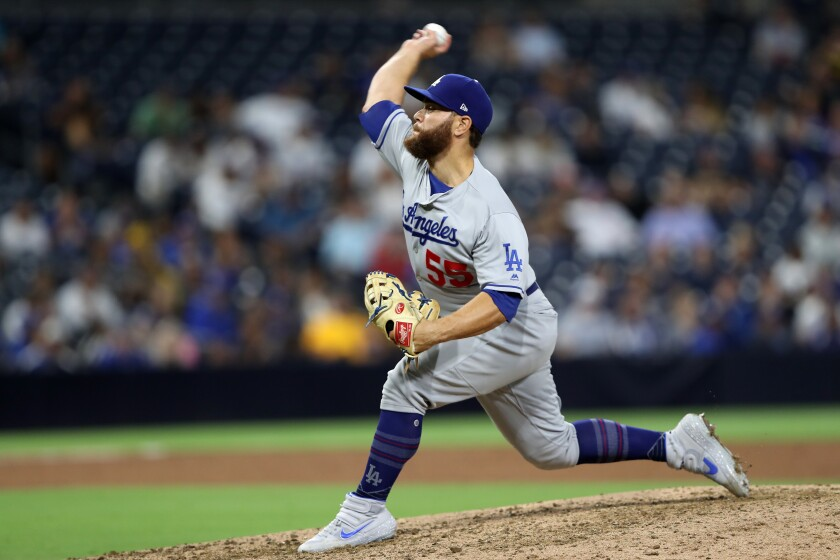 Dodgers catcher Russell Martin pitches during the ninth inning against the San Diego on Tuesday in San Diego.