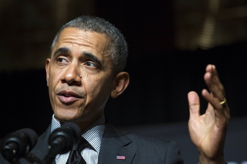 Obamas' federal tax rate rose as their income fell in 2013