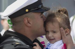 Makin Island, 11th Marine Expeditionary Unit, return from long deployment