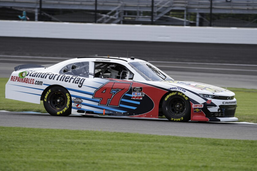 NASCAR Xfinity Series driver Kyle Weatherman drives through a turn during practice for the NASCAR Xfinity Series auto race at Indianapolis Motor Speedway in Indianapolis, Friday, July 3, 2020. The car carries the hashtag #standfortheFlag and features a We Stand for the National Anthem paint scheme. (AP Photo/Darron Cummings)