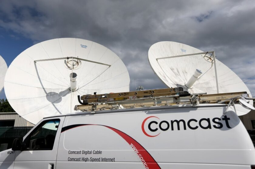 Comcast had protesters at its annual meeting.