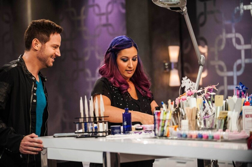 "This photo provided by Oxygen Media shows judge, Tom Bachik, left, and contestant Ashley Craig, during an episode of Oxygen's ""Nail'd It,"" a new reality television show. It features nail artists competing for a $100,000 prize. The show debuts Tuesday, Oct. 7, 2014, on Oxygen. (AP Photo/Oxygen Media, Lindsey Byrnes)"