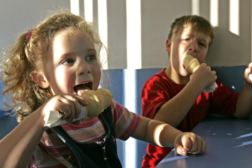 A physicist in Spain has created an ice cream that changes color when you lick it. Pictured are two kids eating ice cream in Placentia, Calif.