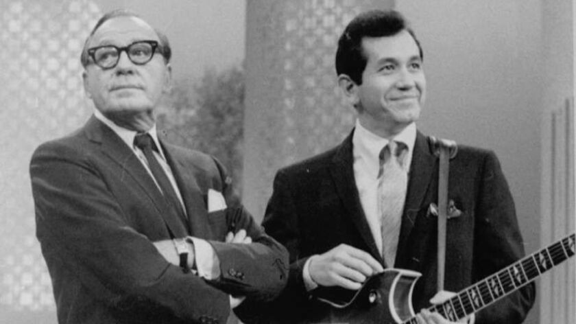 Singer-actor Trini Lopez, shown here during a TV appearance with Jack Benny, has listed his home in Palm Springs for sale at $1.575 million.