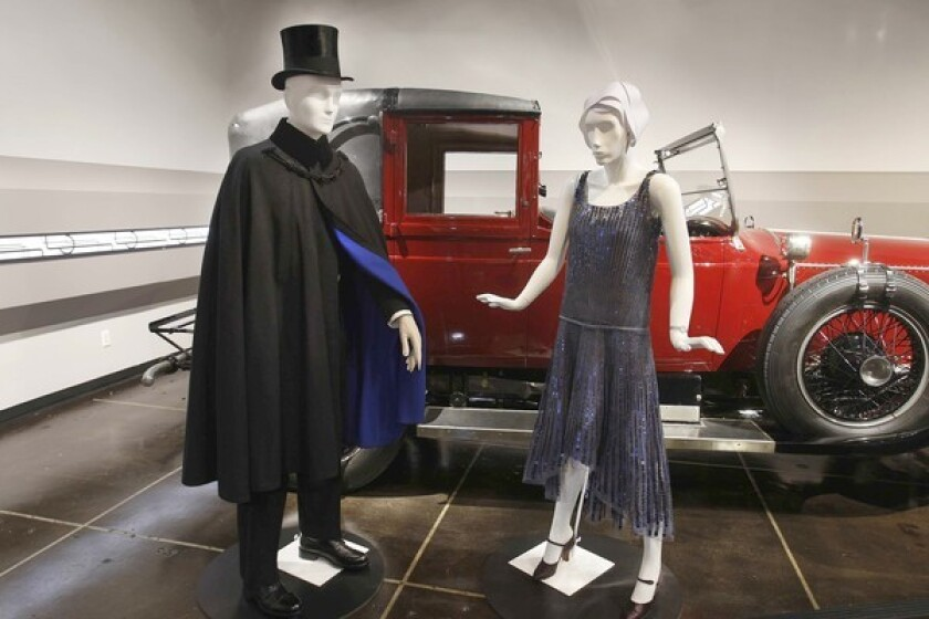 """A 1927 Rolls-Royce Phantom I Town Landaulet by Hooper is paired with a 1920s black wool men's Joseph Cipolari evening cape and a 1928 Gabrielle """"Coco"""" Chanel dress in gray silk tulle with metal sequins."""