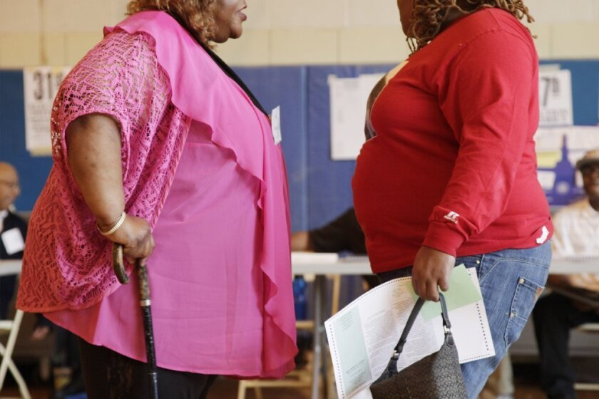 Obese Americans now outnumber overweight Americans, according to a survey of adults ages 25 and above.